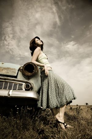 country girls: girl near old car