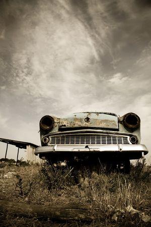 rusty car: Old car at field
