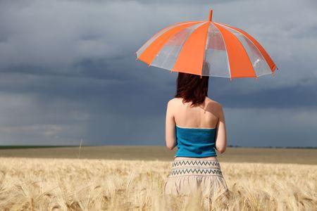 odessa: girl at wheat field with umbrella