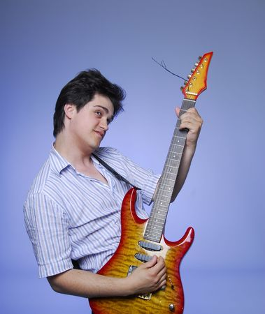 style boy with electro guitar photo
