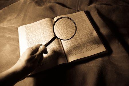 view through: view through loupe at book