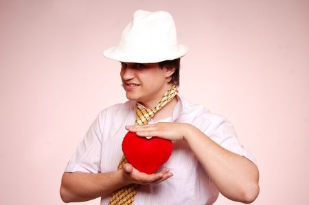 boy with heart in white cap photo