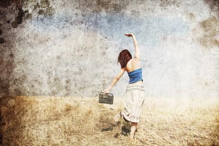 Girl dancing at wheat field road photo