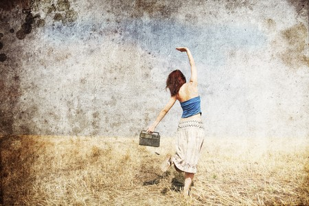 outside of the country: Girl dancing at wheat field road