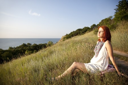 Girl at hill in sunrise.   photo