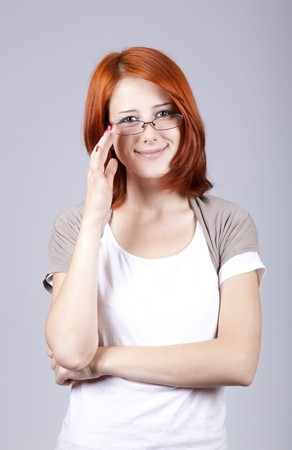 Young angry businesswomen in white with glasses.  photo