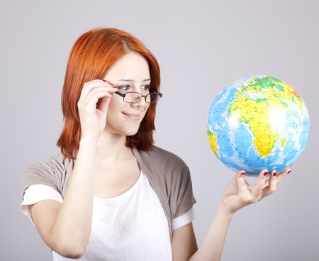 Young businesswomen with globe photo