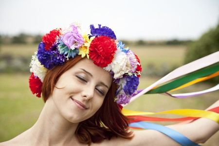Slav girl with wreath at field photo