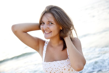 Pretty young woman standing on beach Stock Photo - 7594072