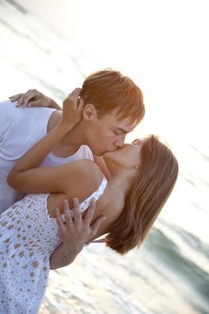 Couple kissing at sunrise Stock Photo - 7594076