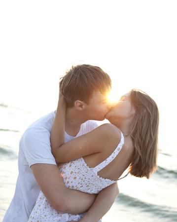 Couple kissing at sunrise Stock Photo - 7594039
