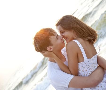 romantic kiss: Couple kissing at sunrise