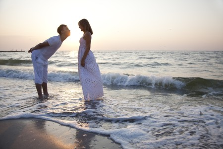 Couple kissing at sunrise Stock Photo - 7594141