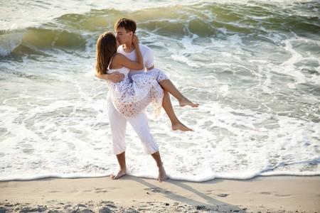 Couple kissing at sunrise Stock Photo - 7594121