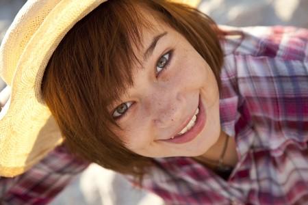 Close-up portrait of beautiful brunet girl in shirt. photo