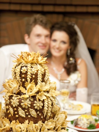 Russian pie and groom and bride on background photo