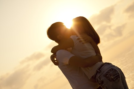 Couple kissing in sunrise at the beach. Stock Photo - 7767194