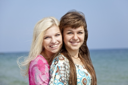Two girlfriends at the beach. photo