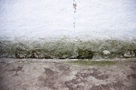 plaster mould: Old cracked wall and floor for background.