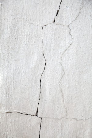 plaster mould: Old cracked white wall for background.