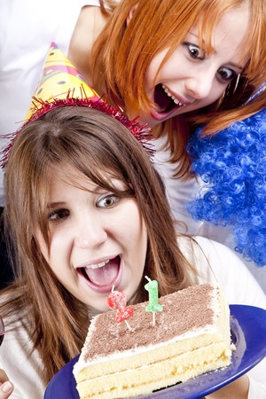 Two girlfriends with cake and wine celebrate 21th birthday photo