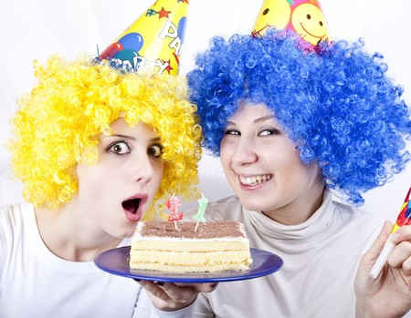 Two girlfriends with cake and wig celebrate 21th birthday Stock Photo - 7941321