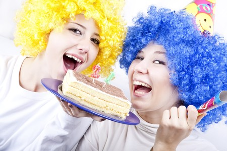 Two girlfriends with cake and wig celebrate 21th birthday photo