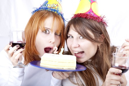 Two girlfriends with cake celebrate 21th birthday  photo