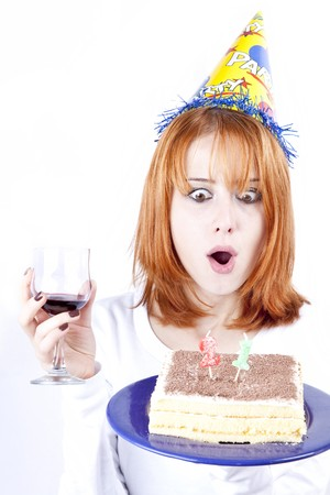 Red-haired with wine glass and cake celebrate her 21th birthday.  photo