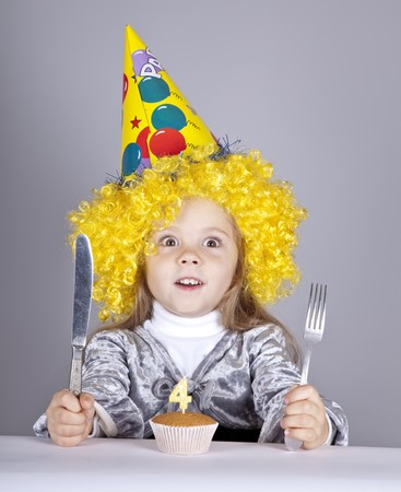 Portrait of young girl at birthday with cake. Studio shot. Stock Photo - 8083761