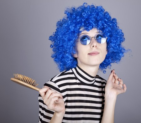 coquette: Coquette blue-hair girl with comb. Studio shot.