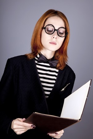 Portrait of beautiful and style red-haired girl with folder. Stock Photo - 8134114