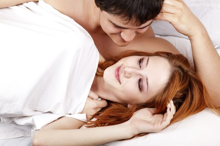 Young attractive happy amorous couple at bedroom  photo