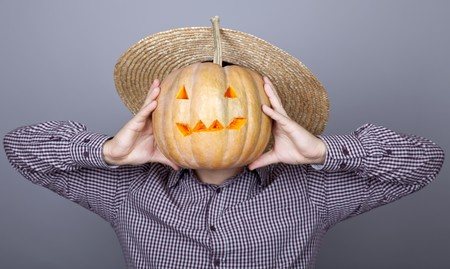 Funny men showing a pumpkin. Studio shot. Stock Photo - 8134087