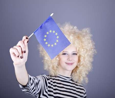 ringlets: Beautiful girl with ringlets show European Union flag. Studio shot.