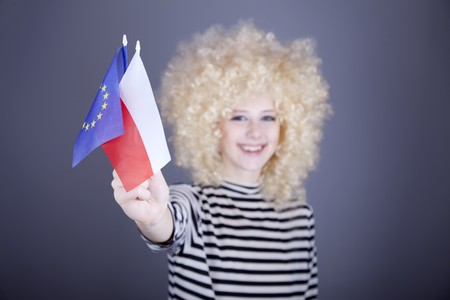 ringlets: Beautiful girl with ringlets show European Union and Poland flag. Studio shot.