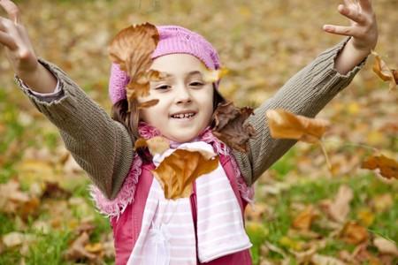 Cute girl in autumn park. Portrait shot. photo