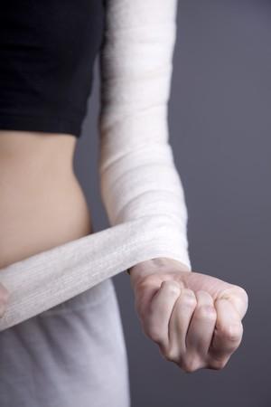 Strong girl's body with with elastic bandage on hand. Studio shot. Stock Photo - 8134233