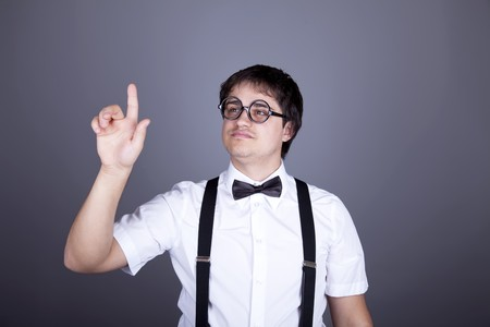 suspender: Portrait of funny fashion men in suspender with bow tie and glasses. Studio shot.