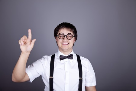 Portrait of funny fashion men in suspender with bow tie and glasses. Studio shot. photo