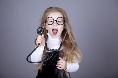 Little girl with  stethoscope. Studio shot.
