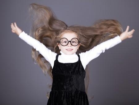 Little girl with long hair. Studio shot. photo