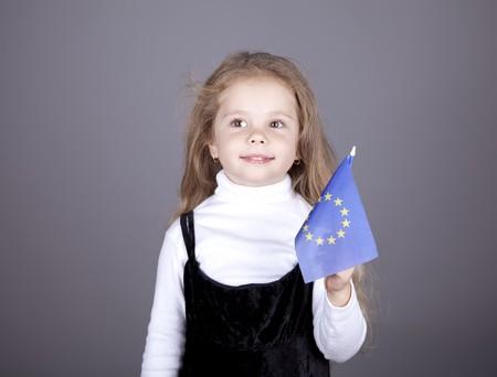 Little girl with european union flag. Studio shot. Stock Photo - 8141670