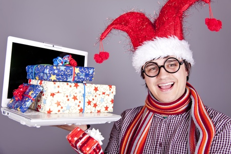 Funny men in christmas cap with gift boxes and notebook. Studio shot. photo