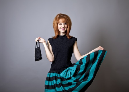 60s fashion: Girl in american 50s-60s style with handbag. Stock Photo