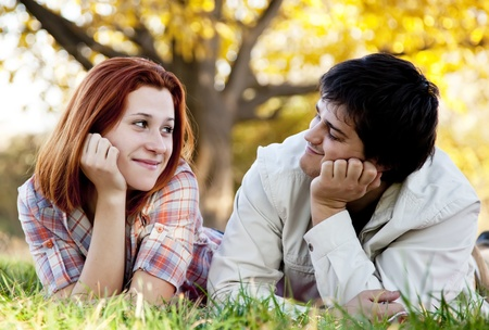 Young couple at grass in the park. photo