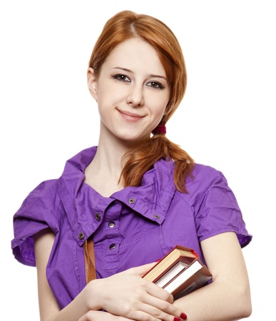 Red-haired girl keep book in hand. Studio shot. Stock Photo - 9125179
