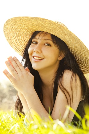 Beautiful brunette girl in hat at the park. photo