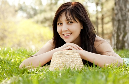 teen girl face: Beautiful brunette girl with hat at the park.