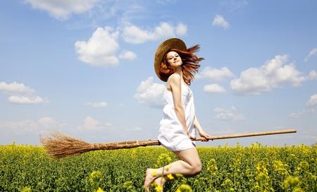 enchantress: Redhead enchantress fly over spring rapeseed field at broom.